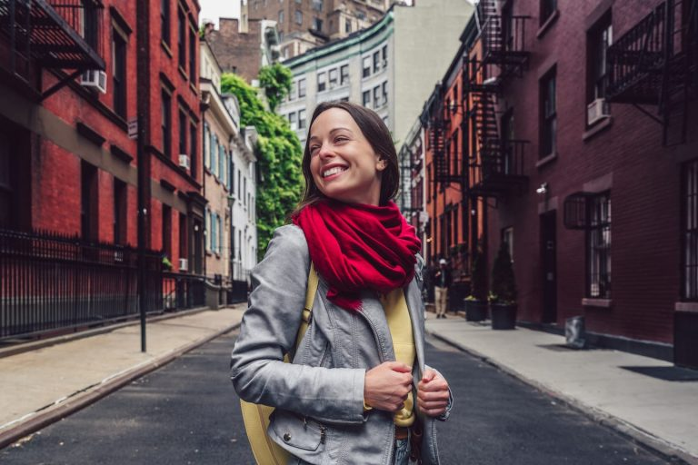smiling girl on a famous street GFLMX4Z