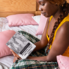 mockup of a woman holding a hard cover book 23711