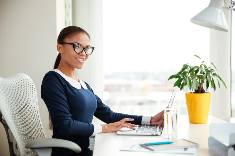 graphicstock african business woman in dress sitting on armchair in office and looking at camera BUoOrDmdhe