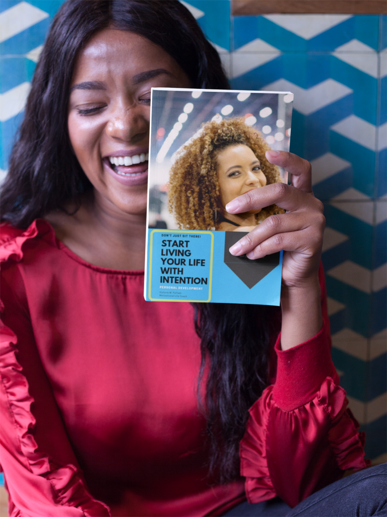 happy black woman holding a book mockup near her face a17344