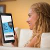 young woman using tablet on a sofa android mockup 1